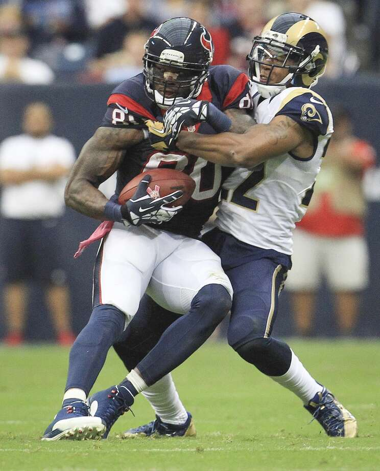 Texans wide receiver Andre Johnson catches a pass against the defense of Rams cornerback Trumaine Johnson. Photo: Karen Warren, Houston Chronicle