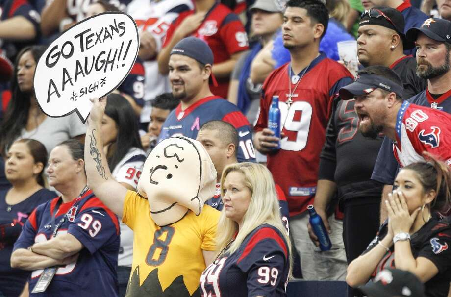 A Texans fan wears a Charlie Brown costume and expresses dismay to the Texans play against the Rams. Photo: Brett Coomer, Houston Chronicle