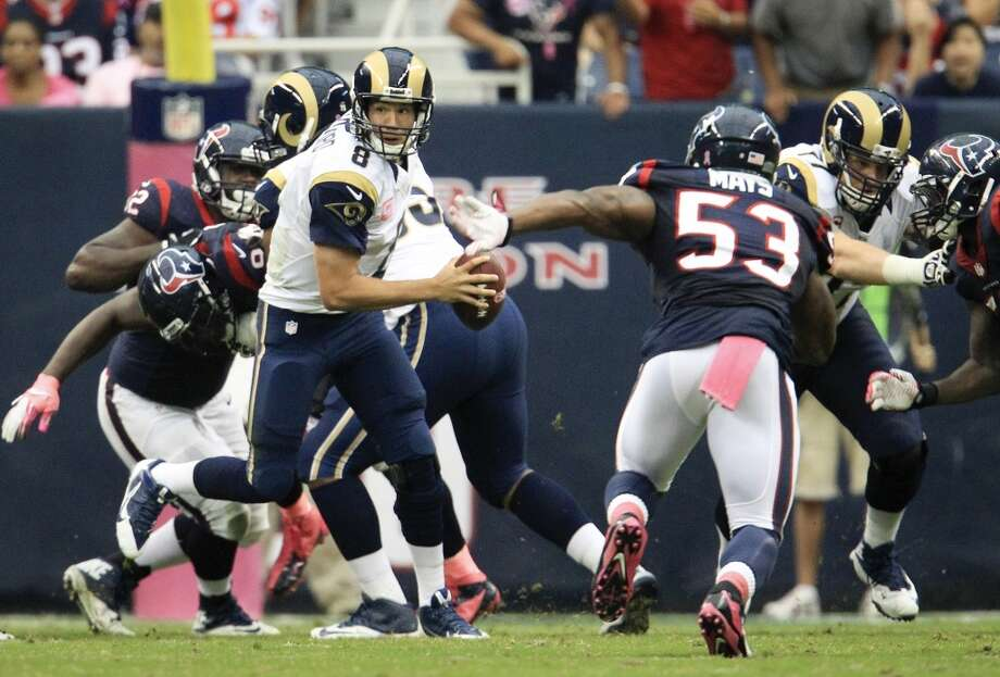 Rams quarterback Sam Bradford scrambles during the third quarter. Photo: Karen Warren, Houston Chronicle