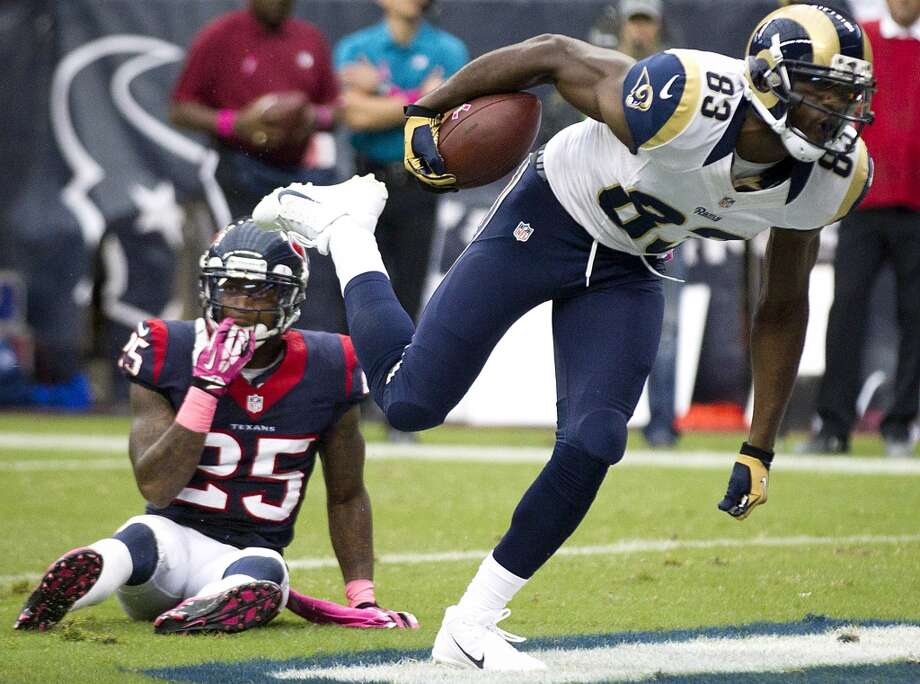 Rams wide receiver Brian Quick breaks away from Texans cornerback Kareem Jackson for a 4-yard touchdown reception during the third quarter. Photo: Brett Coomer, Houston Chronicle
