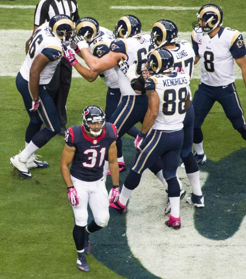 Texans free safety Shiloh Keo (31) walks away as Rams players celebrate a touchdown reception by tight end Cory Harkey (46) during the first half. Photo: Smiley N. Pool, Houston Chronicle