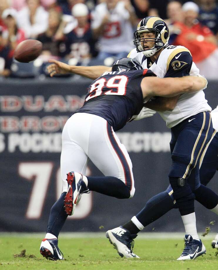 Texans defensive end J.J. Watt hits Rams quarterback Sam Bradford. Photo: Karen Warren, Houston Chronicle