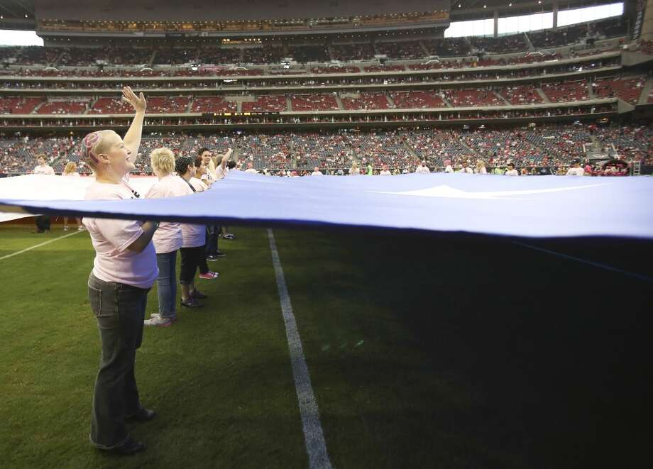 Texans fans who have a connection to cancer will hold the Texas flag during pregame festivities. Photo: Karen Warren, Houston Chronicle