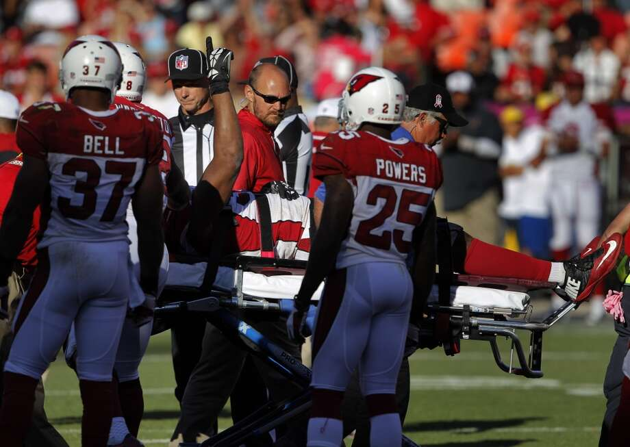 Arizona's Calais Campbell points up as he is taken off the field in a stretcher in the fourth quarter. The San Francisco 49ers played the Arizona Cardinals at Candlestick Park in San Francisco, Calif., on Sunday, October 13, 2013. Photo: The Chronicle