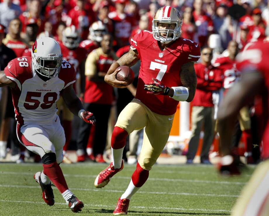 Colin Kaepernick (7) took off for a first down in the first half Sunday October 13, 2013 in San Francisco, Calif. The San Francisco 49ers beat the Arizona Cardinals 32-20 at Candlestick Park. Photo: The Chronicle
