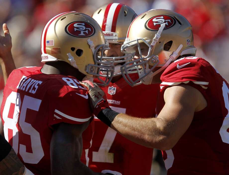 Vernon Davis (85) is congratulated by Colin Kaepernick (center) and others after a first half touchdown Sunday October 13, 2013 in San Francisco, Calif. The San Francisco 49ers beat the Arizona Cardinals 32-20 at Candlestick Park. Photo: The Chronicle
