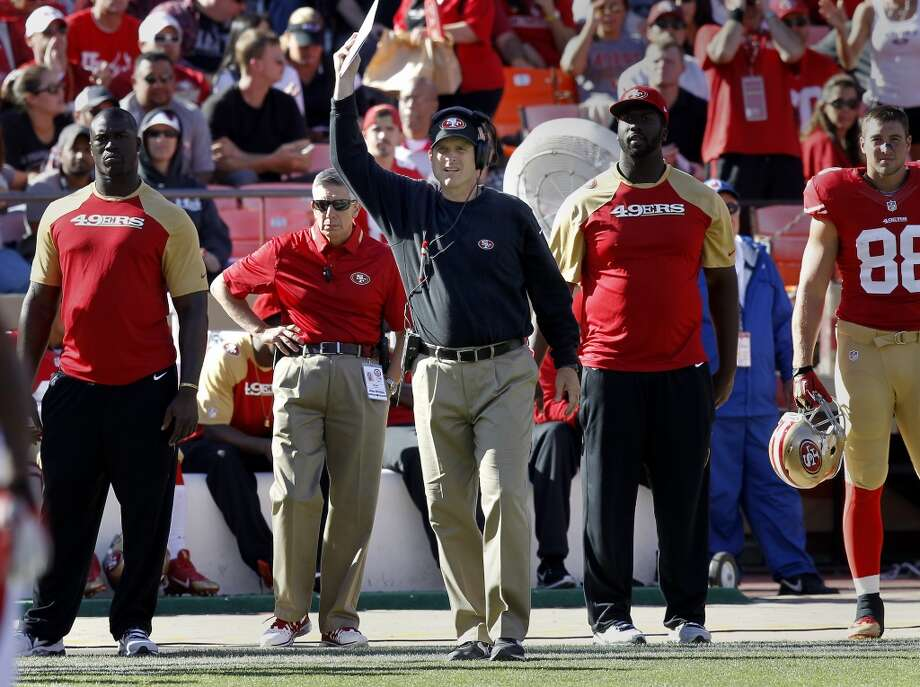 49ers head coach Jim Harbaugh urged the crowd to make noise during a second half play Sunday October 13, 2013 in San Francisco, Calif. The San Francisco 49ers beat the Arizona Cardinals 32-20 at Candlestick Park. Photo: The Chronicle