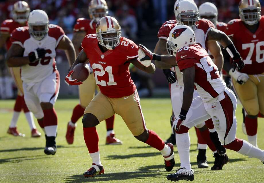 Frank Gore (21) pushed off defender Jerraud Powers (25) during a runback in the second half Sunday October 13, 2013 in San Francisco, Calif. The San Francisco 49ers beat the Arizona Cardinals 32-20 at Candlestick Park. Photo: The Chronicle