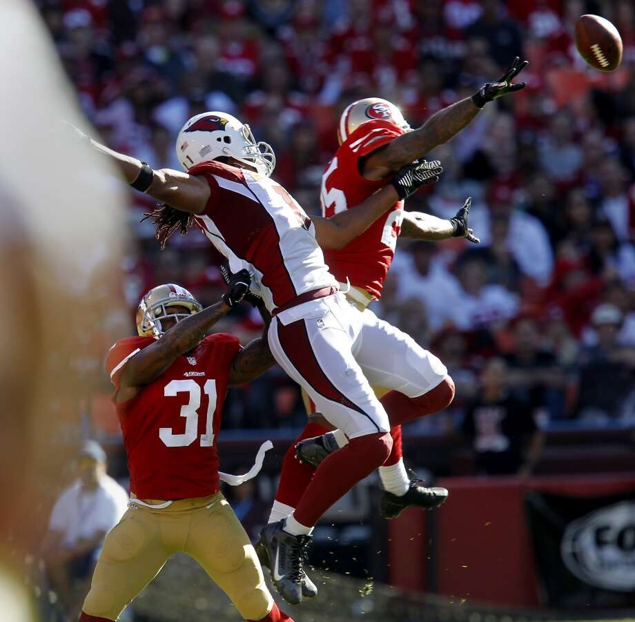 Donte Whitner (31) and Tarell Brown (25) broke up a pass to Larry Fitzgerald Sunday October 13, 2013 in San Francisco, Calif. The San Francisco 49ers beat the Arizona Cardinals 32-20 at Candlestick Park. Photo: The Chronicle