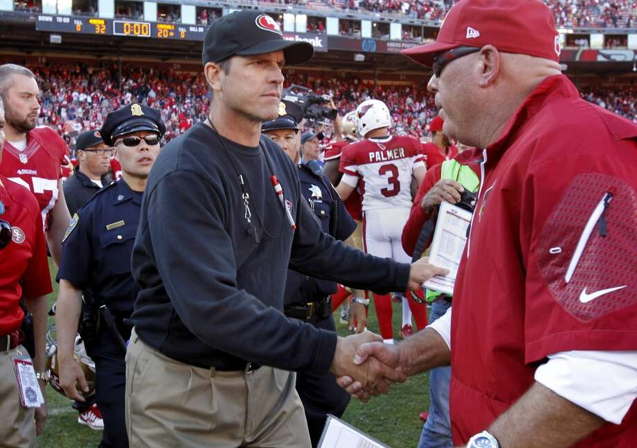 49ers head coach Jim Harbaugh (center) shook hands with Cardinals coach Bruce Arians Sunday October 13, 2013 in San Francisco, Calif. The San Francisco 49ers beat the Arizona Cardinals 32-20 at Candlestick Park. Photo: The Chronicle