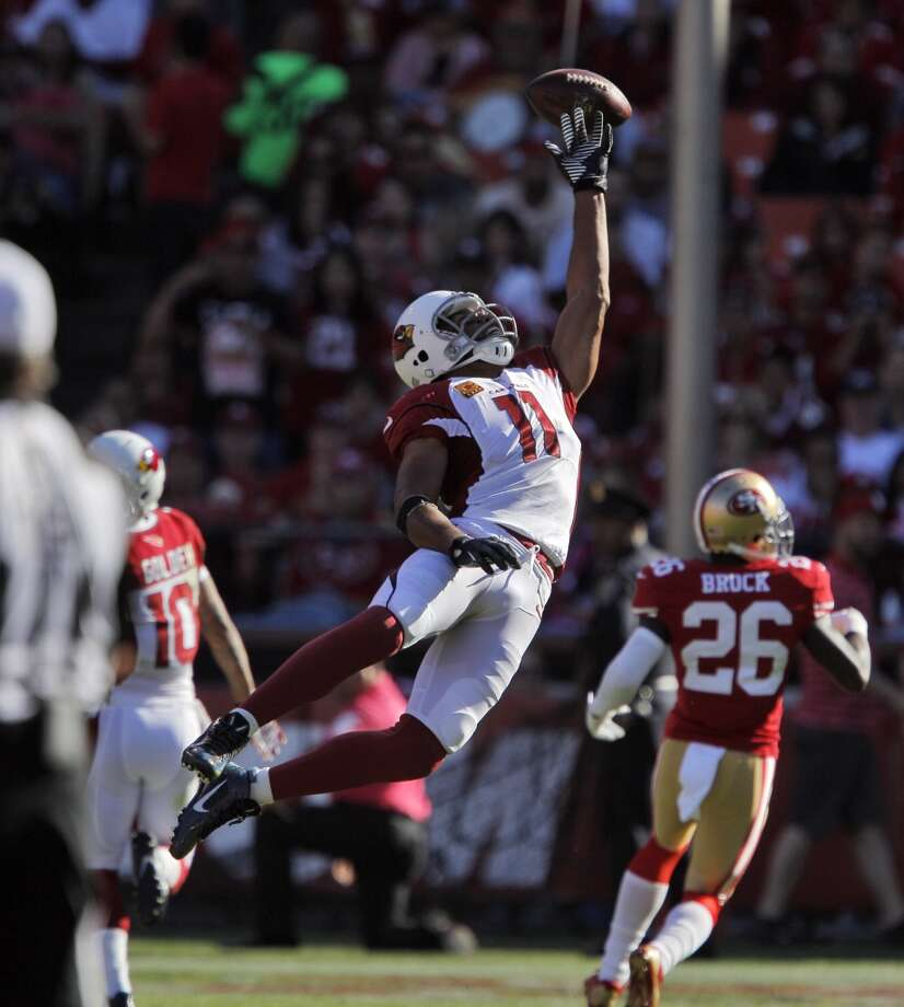 Larry Fitzgerald can't get to a pass thrown over his head by Carson Palmer in the third quarter. The San Francisco 49ers played the Arizona Cardinals at Candlestick Park in San Francisco, Calif., on Sunday, October 13, 2013. Photo: The Chronicle
