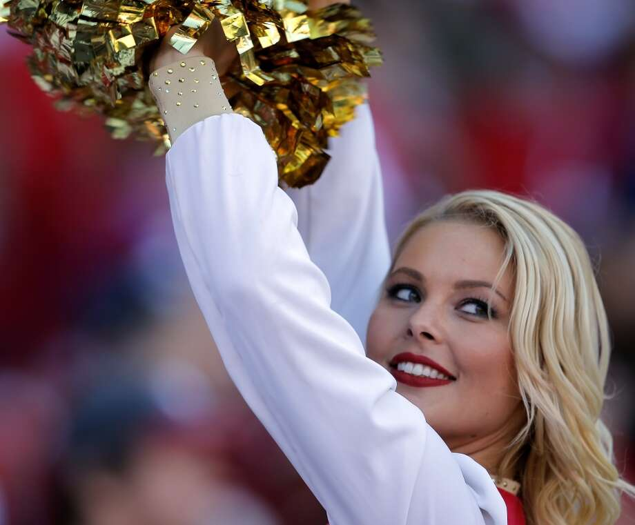 A Gold Rush cheerleader performs as the San Francisco 49ers faced the Arizona Cardinals on Oct. 13, 2013. Photo: The Chronicle