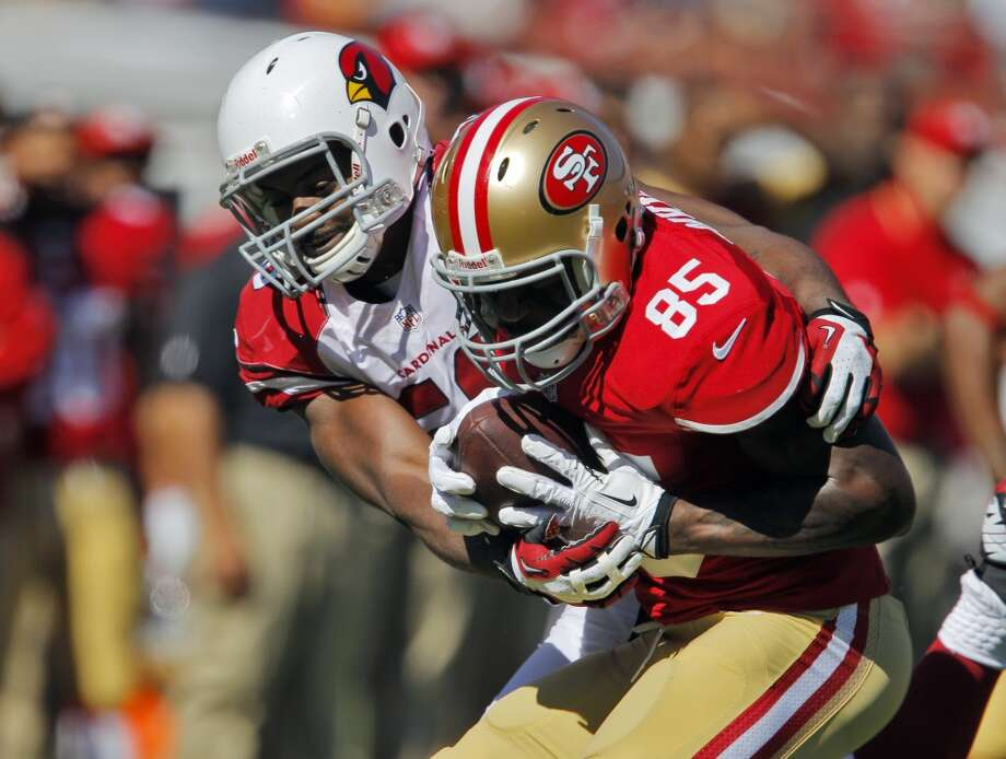Vernon Davis catches a ball under pressure and turns upfield in the second quarter agains the Cardinals. The San Francisco 49ers played the Arizona Cardinals at Candlestick Park in San Francisco, Calif., on Sunday, October 13, 2013. Photo: The Chronicle