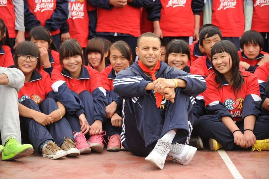 Stephen Curry of the Golden State Warriors interacts with the kids at the NBA Cares Reading and Learning Center as part of 2013 Global Games on October 14, 2013 at the Taijing Migrant School in Beijing, China. Photo: Randy Belice, NBAE/Getty Images