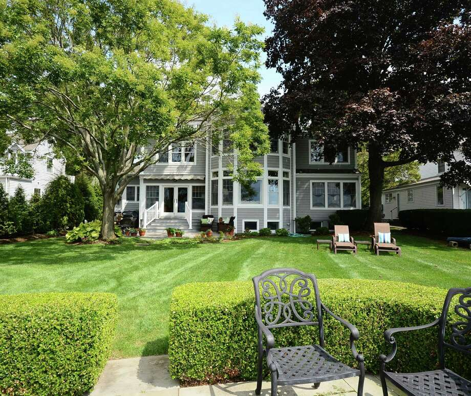 The 1921 updated Colonial at 34 Beach Drive in Darien, on the market for $2,925,000, has a view overlooking Holly Pond. Photo: Contributed Photo, Contributed / Darien News