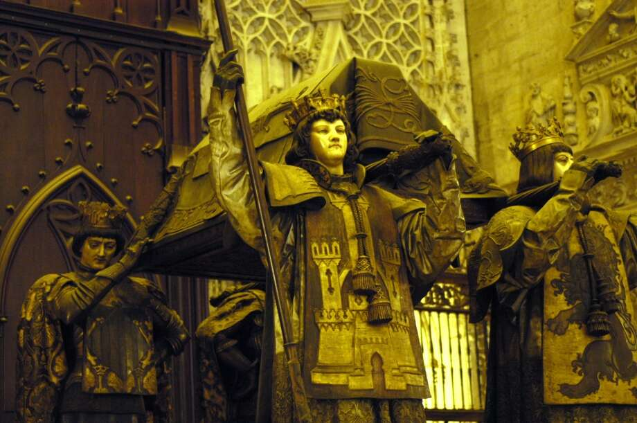 The four pallbearers are wearing the symbols of the four kingdoms of Spain at the time of Columbus' voyages. (It's said the figures were based on the kings of those regions at the time.) Photo: Spud Hilton, The Chronicle