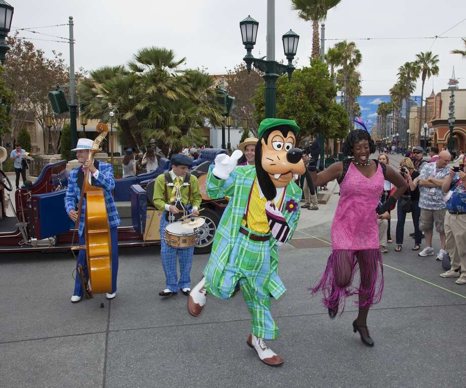 Five & Dime: This musical group jazzes things up when they arrive in front of Carthay Circle at California Adventure.  Goofy even joins in the toe-tapping fun. Photo: Paul Hiffmeyer, Paul Hiffmeyer / Disney