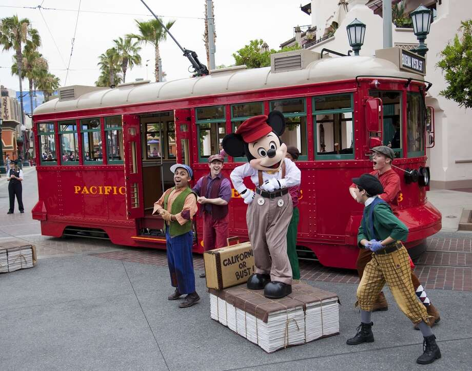 Red Car News Boys: These old-school newspaper salesmen roll onto Buena Vista Street at Disney California Adventure on the Red Car Trolley bringing the latest headlines and belting out songs from the '20s and '30s. Mickey Mouse joins in the fun during the high-energy show. Photo: Paul Hiffmeyer, Paul Hiffmeyer / Disney