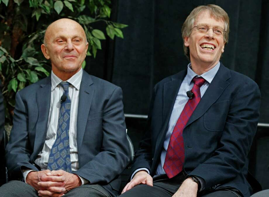 Nobel Prize winners Eugene Fama, 74, left, and Lars Peter Hansen, 60, of the University of Chicago speak at a news conference  Monday, Oct. 14, 2013, in Chicago, after being named two of the three winners of the 2013 Nobel Prize for Economics. They share the prize with Robert Shiller, 67, of Yale University. All three studied the movement of prices of assets but they came at it from different angles. Photo: M. Spencer Green, Associated Press / Associated Press