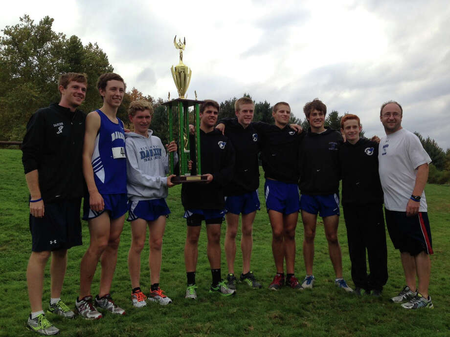From left, coach Peter Watson, Brian Davey, Armstrong Noonan, Ben Olsen, Marshall Huffman, Peter Kreuch, Colten Appleby, Alex Ostberg and coach Tyson Kaczmarek pose for a picture with the championship trophy. Photo: Contributed Photo / Darien News