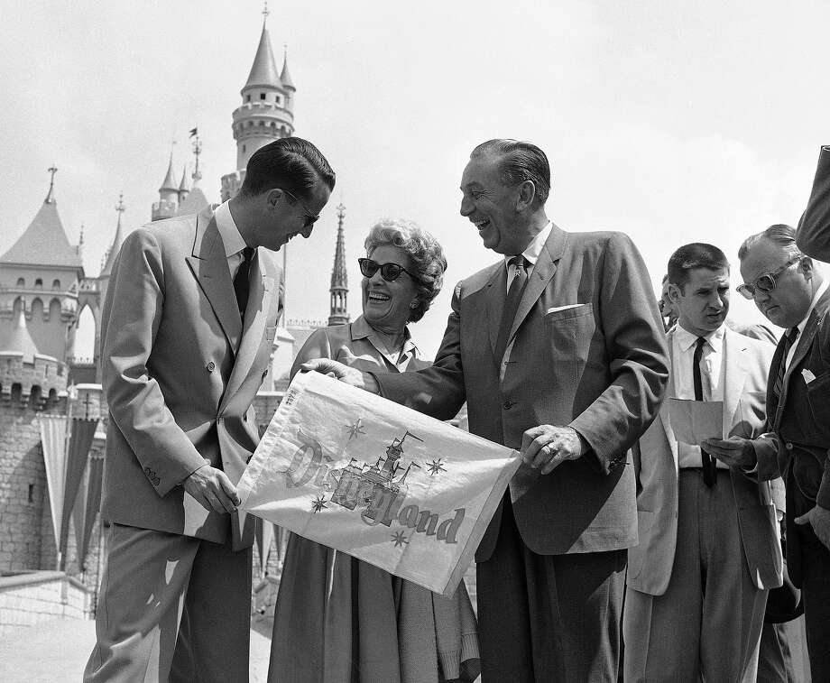 Above: Walt Disney and his wife present King Baudouin of Belgium with a memento of his visit as they welcome him to Disneyland in Anaheim, May 20, 1959. Disney gave the visiting monarch a personally-conducted tour through the amusement park and took him on some of the more familiar rides. Photo: Don Brinn, ASSOCIATED PRESS / AP1959