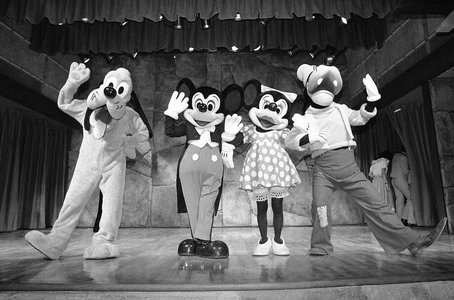 April 15, 1983:Tokyo Disneyland, the first international Disney theme park, opens in Japan. (thewaltdisneycompany.com)  Above: Mickey Mouse and other Disney characters wave to visitors at a press performance staged at the new Tokyo Disneyland in Urayasu on Tuesday, Jan. 25, 1983, which opens in April. Promoters are counting on the Disney name and magic to attract the millions of Japanese who live in the Tokyo Metropolitan area. Photo: Itsuo Inoue, AP / AP