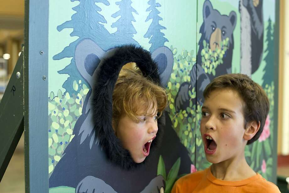Beware of the bear: In Knoxville, Tenn., 10-year-old Asher Weisfeld is startled by a bruin bearing a striking resemblance to his sister, 