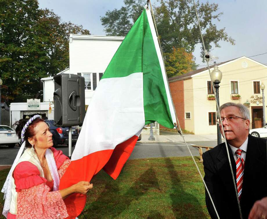Gina Clarizio as Queen Isabella, and Matt Knickerbocker, Bethel first selectman, raise the Italian flag during the 31st annual Columbus Day observance in Bethel, Conn. Monday, Oct. 14, 2013. Photo: Michael Duffy / The News-Times