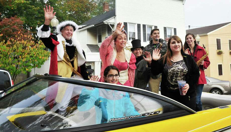 Rich Zuvich as Christopher Columbus, left, and Gina Clarizio as Queen Isabella, center, are among those arriving at P.T. Barnum Square for the 31st annual Columbus Day observance in Bethel, Conn. Monday, Oct. 14, 2013. Photo: Michael Duffy / The News-Times