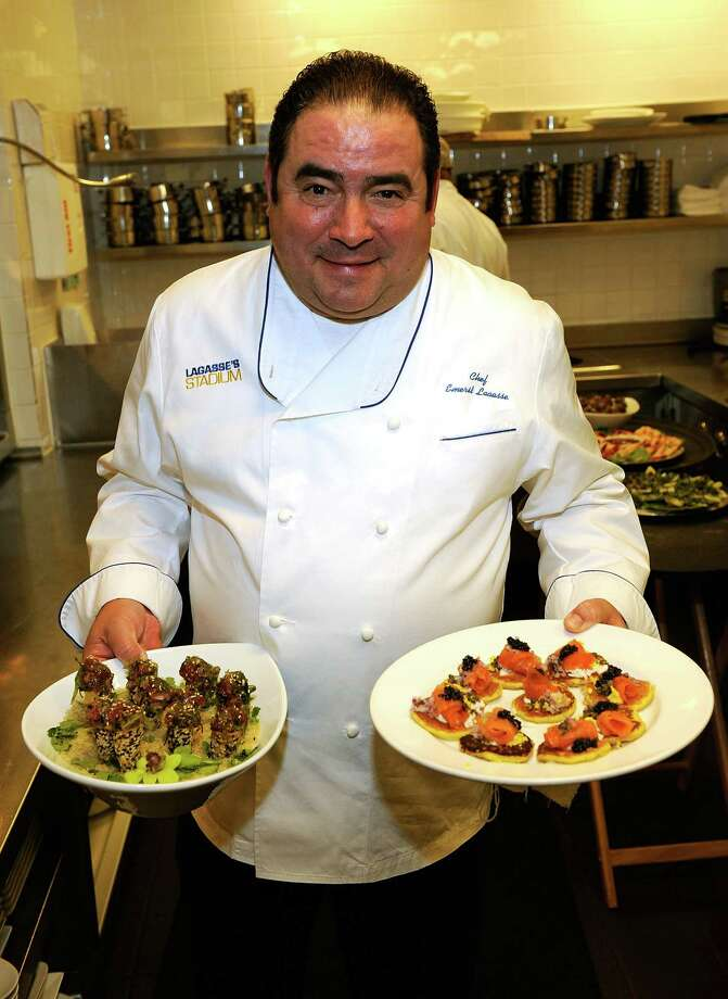 LAS VEGAS - DECEMBER 02:  Chef Emeril Lagasse poses with two plates of food during a NASCAR Evening with Emeril Lagasse at Delmonico Steakhouse in the Venetian Resort Hotel & Casino during day one of the NASCAR Sprint Cup Series Champions Week on December 2, 2009 in Las Vegas, Nevada.  (Photo by Ethan Miller/Getty Images for NASCAR) Photo: Ethan Miller / 2009 Getty Images