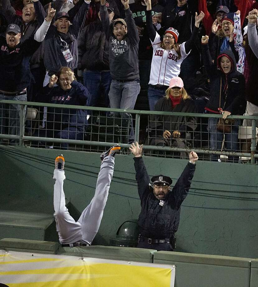 Boston police officer Steve Horgan will make sure that Torii Hunter is OK right after he finishes celebrating: Let's face it, dramatic eighth-inning, game-changing grand slams don't happen every day. (ALDS, Fenway Park.) Photo: Stan Grosfeld, Associated Press