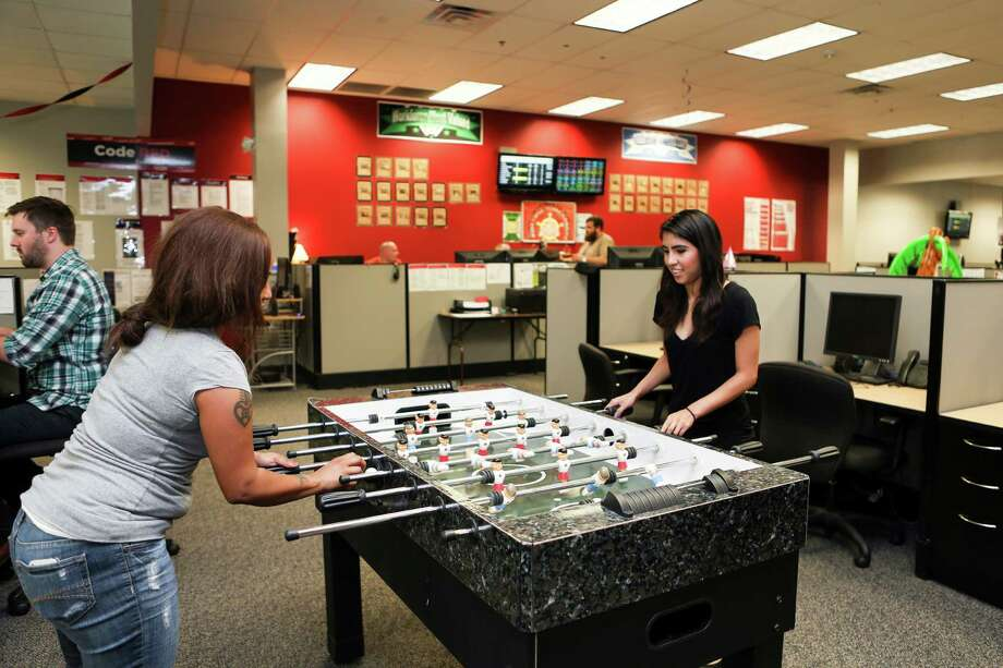 (Left to Right) Senior Performance Managers at Red Ventures Sheyla Melendez and Brendan Clair meet in the San Antonio sales center.
