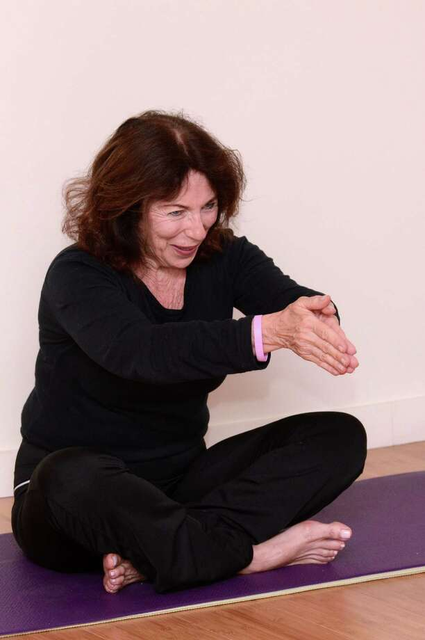 Susan Kiley of Trumbull leads a yoga class at the Watermark at 3030 Park in Bridgeport, Conn. Kiley was recently honored by St. VincentâÄôs Medical Center for her work teaching yoga to cancer patients. Photo: Contributed Photo / Connecticut Post Contributed