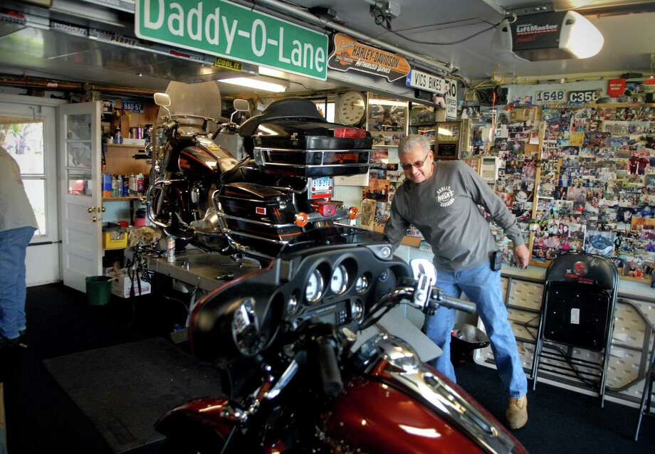 Victor Chiappetta works on his motorcycles in his garage in the Cove section of Stamford, Conn. on Monday October 14, 2013. Photo: Dru Nadler / Stamford Advocate Freelance