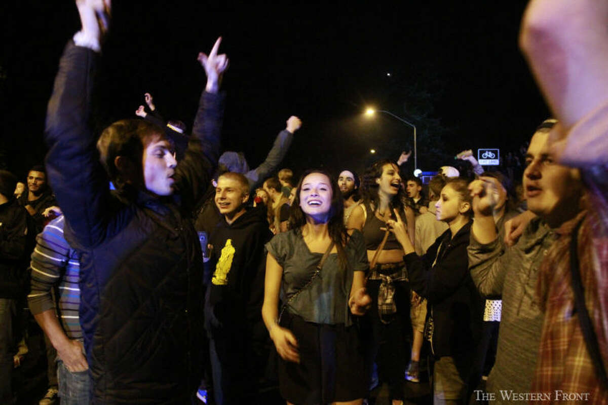 People filled Indian street next to Laurel Park on Saturday night, Oct. 12, 2013, in Bellingham, Wash. People were throwing beer bottles and other objects at idling police cars. (Nick Gonzales, courtesy of The Western Front, special to seattlepi.com)