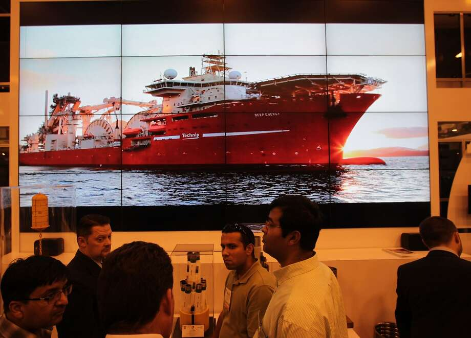 A video monitor wall displays the Technip Deep Energy ship at the company's booth during the 2013 Offshore Technology Conference in Houston. Photo: James Nielsen, Houston Chronicle