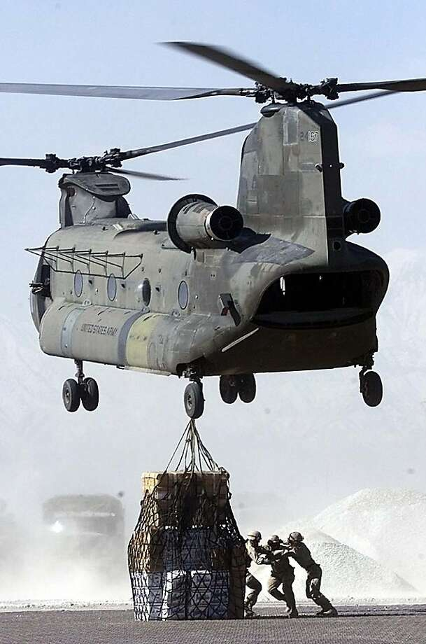 A Chinook helicopter takes off with cargo at Afghanistan's Bagram Air Base north of Kabul, Thursday March 14, 2002.  (AP Photo/Mikhail Metzel) Photo: Mikhail Metzel, AP