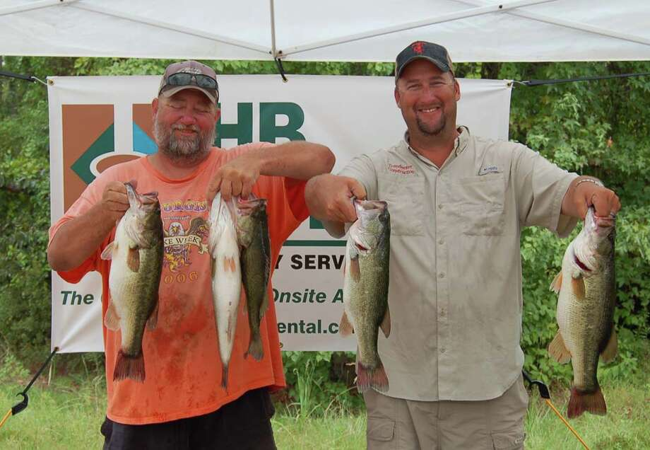 Donald Randall and Joel Cambell brought in the largest stringer of the tournament on day two, vaulting them from a 4th place position on day one to win the tournament and a brand new Phoenix boat  Photo by Patty Lenderman, Lakecaster