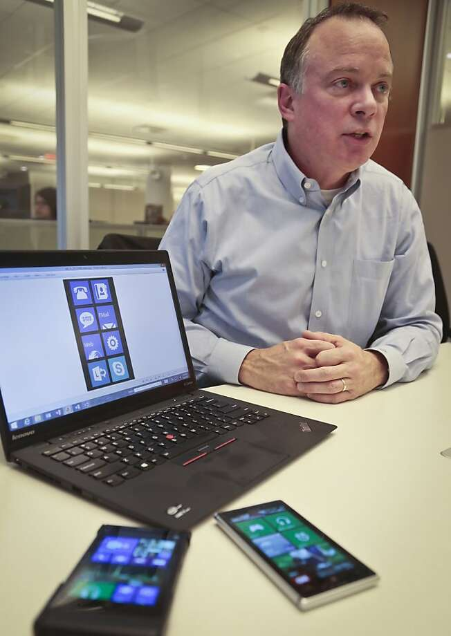 Greg Sullivan, director for Microsoft Windows phone, speaks during an interview on Tuesday, Oct. 8, 2013.  Microsoft is updating its Windows software for cellphones to accommodate larger devices and make it easier for motorists to reduce distractions while driving.  (AP Photo/Bebeto Matthews) Photo: Bebeto Matthews, Associated Press