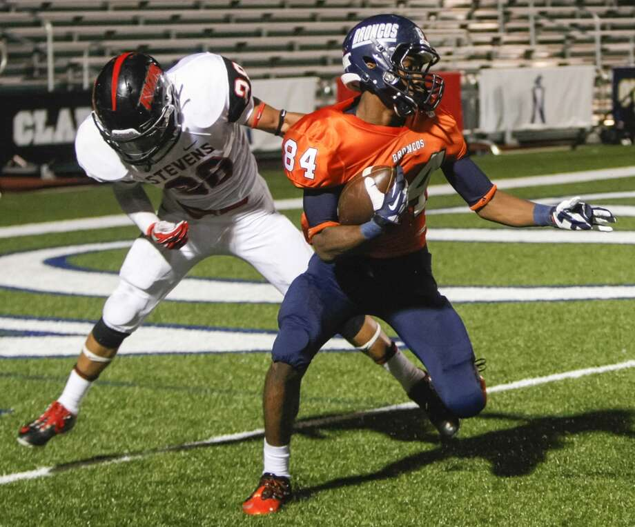 Brandeis wide receiver Larry Stephens (right) spins away from Stevens Romello Garcia at the goal line before scoring a 41-yard touchdown, his second of the night, during the second quarter of their game at Farris Stadium on Saturday, Sept. 29, 2013.  Stevens added another touchdown catch in the third quarter, finishing the night with 5 catches for 163 yards as the Broncos beat the Falcons 42-7. Photo: Marvin Pfeiffer, San Antonio Express-News