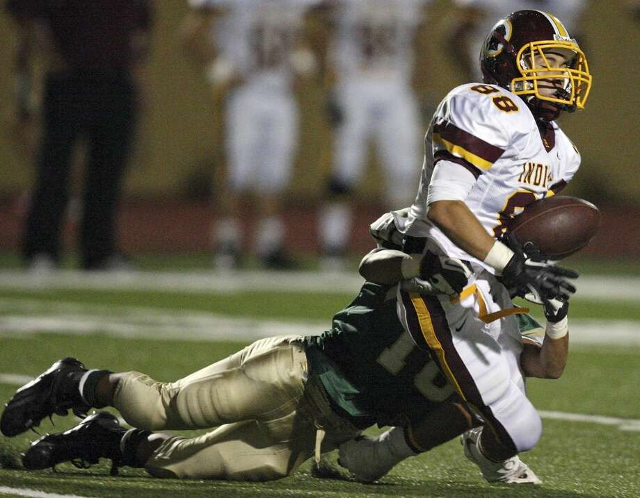 Harlandale's James Mendoza fumbles the kickoff as he is hit by McCollum's Jeff Valdez during second half action of the Frontier Bowl Friday Nov. 9, 2012 at Harlandale Memorial Stadium. Harlandale won in double overtime 43-36. Photo: Edward A. Ornelas, San Antonio Express-News