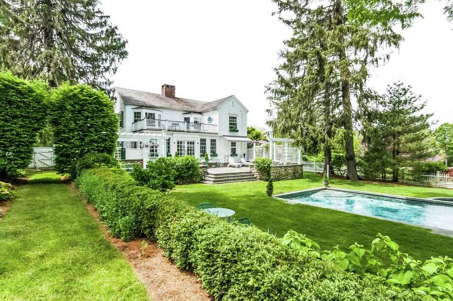 The house at 11 Clapboard Hill Road, with its expansive grounds and pool, is on the market for $3.8 million. Photo: Contributed Photo / Westport News contributed