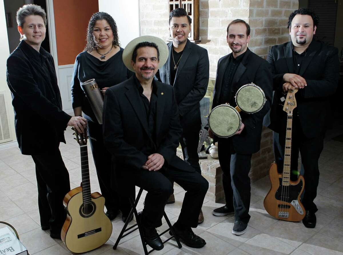 Members of the band Mango Punch Frankie Ackerman, left, Doris Réos, Walter Suhr, leader, J.P. Réos, Jeséºs Pacheco, and Richard Soliz, right, pose together Wednesday, Sept. 18, 2013, in Houston. ( Melissa Phillip / Houston Chronicle )