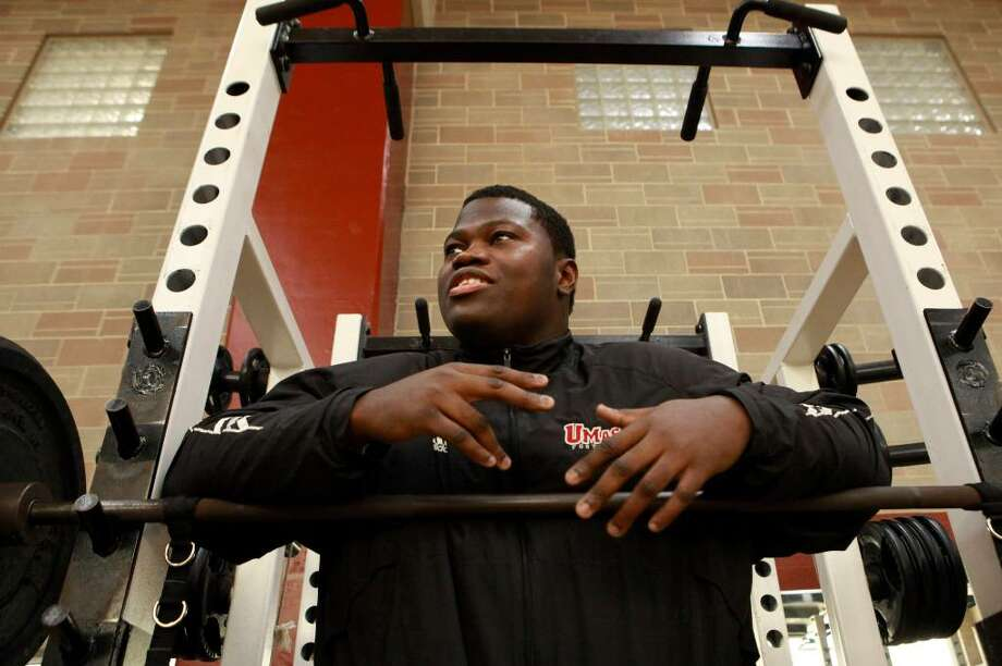 University of Massachusetts offensive tackle Vladimir Ducasse, originally from Haiti, speaks with a reporter in a gym on the school's campus, in Amherst, Mass., on Friday, Jan. 22, 2010. Ducasse, who has lived in the United States since he was 14, is headed to the Senior Bowl college all-star football game with thoughts of impressing pro scouts, and concerns about his native Haiti. (AP Photo/Steven Senne) Photo: Steven Senne, AP / AP