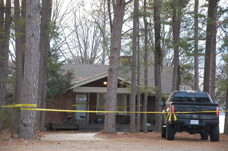 Yellow crime-scene tape blocks off the home of Mindy McCready in Heber Springs, Ark., on Monday, Feb. 18, 2013, the day after the country singer was found dead there Sunday in an apparent suicide. She was 37. Photo: Jeannie Nuss, Associated Press