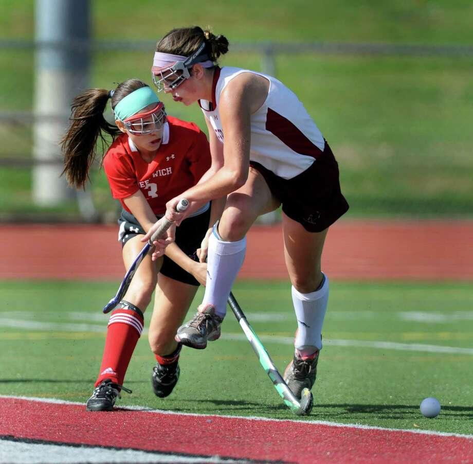 #3 for Greenwich High School, Sydney Cole, left, and #6 for Pomeraug High School, Alyssa Vagnini, play field hockey Pomperaug High School, Monday, Oct. 14, 2013. Photo: Carol Kaliff / The News-Times