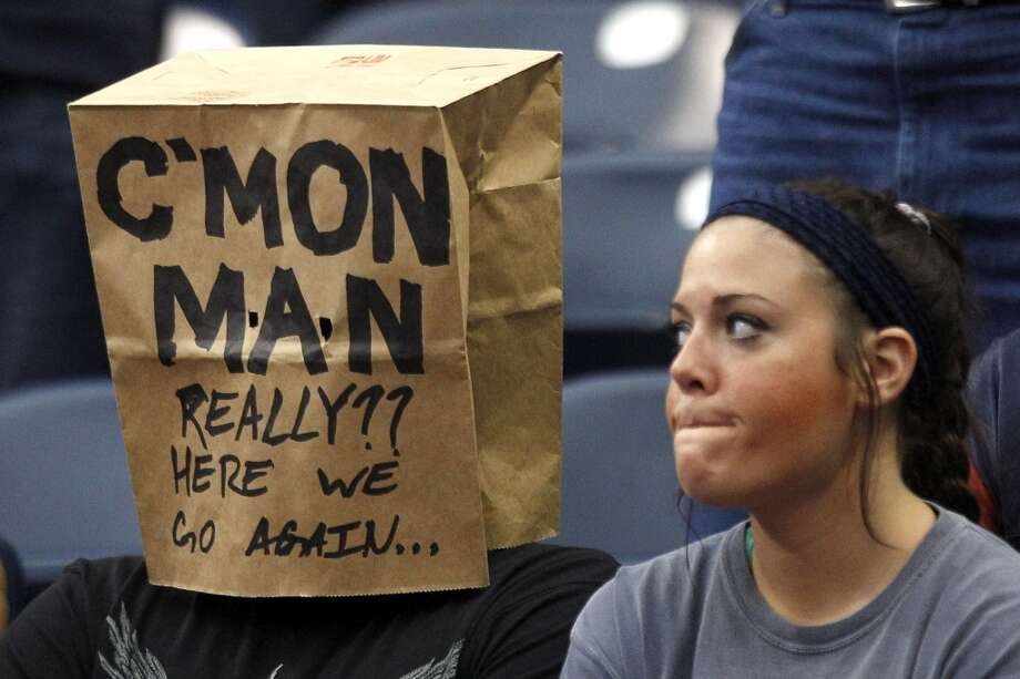A Texans fan wears a bag over his head during the fourth quarter of the Texans loss to the Rams. Photo: Brett Coomer, Houston Chronicle