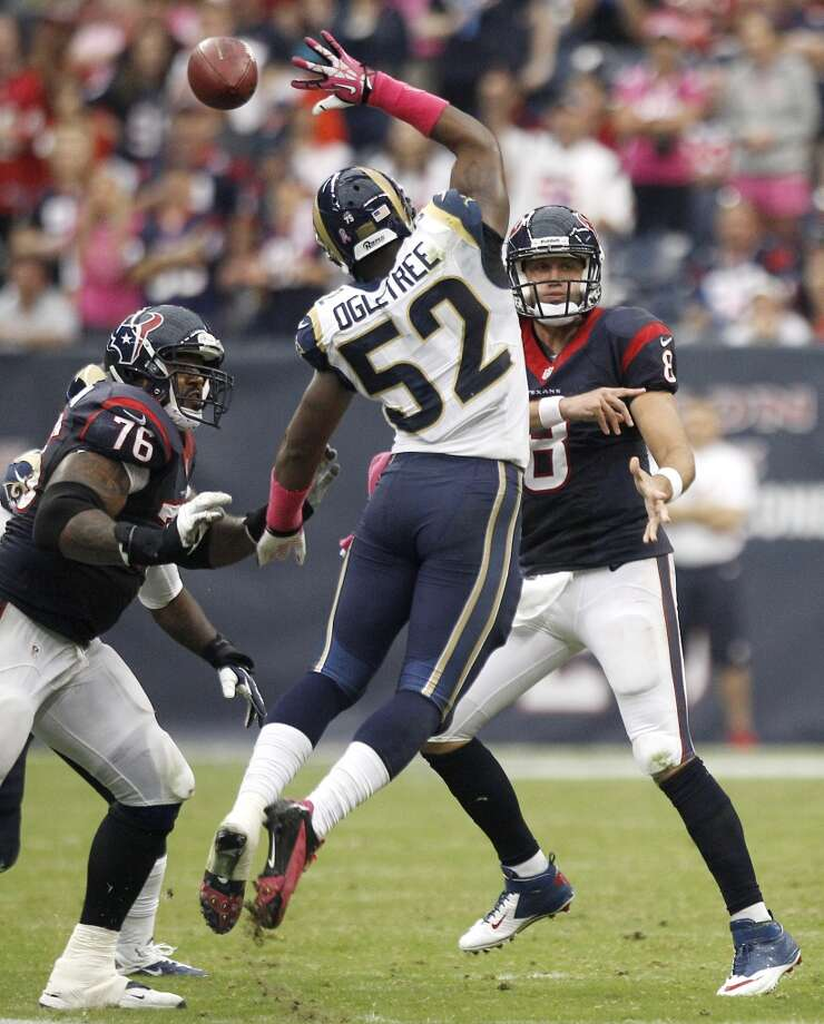 Texans quarterback Matt Schaub (8) throws the ball over the outstretched hand of Rams outside linebacker Alec Ogletree (52). Photo: Brett Coomer, Houston Chronicle