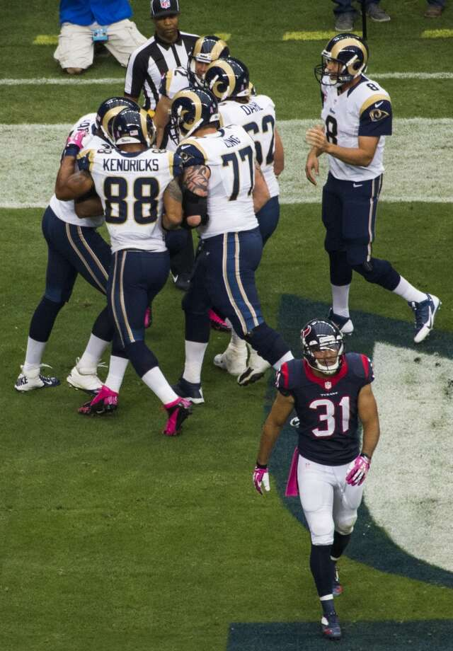 Texans free safety Shiloh Keo (31) walks away as Rams players celebrate a touchdown reception by tight end Cory Harkey (46). Photo: Smiley N. Pool, Houston Chronicle