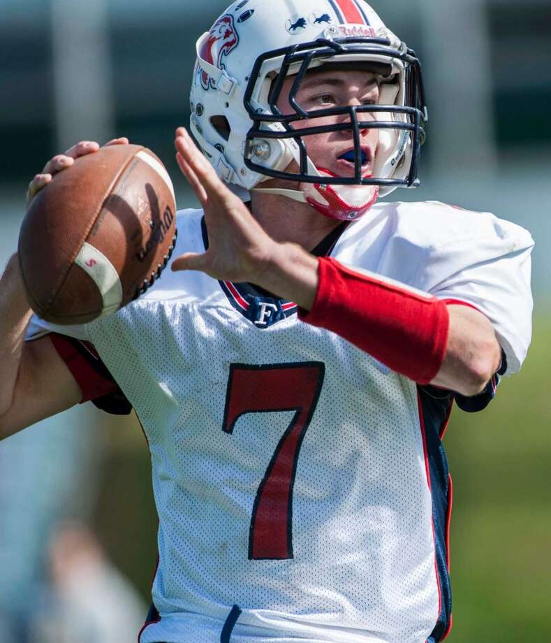 Foran high school quarterback Jake Kasuba looks downfield for a receiver during a football game against Trinity Catholic high school played at Trinity in Stamford, CT on Saturday, October, 12th, 2013 Photo: Mark Conrad
